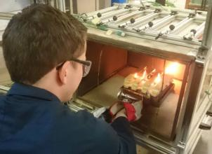 Undergraduate student working in the fire lab